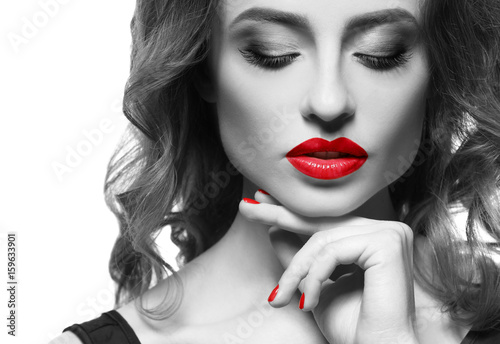 Young woman with red lips on white background
