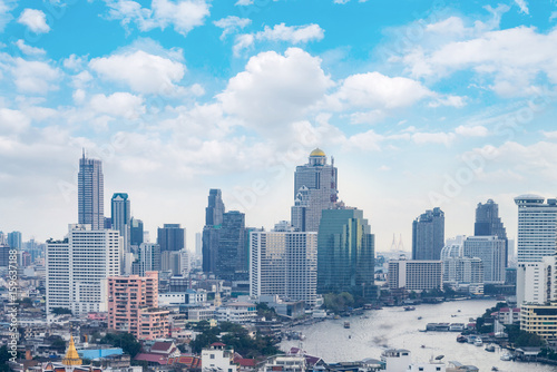 Poster Los Angeles cityscape Bangkok skyline, Thailand. Bangkok is metropolis and favorite of tourists live at between modern building / skyscraper, office building and Community residents with blue sky and cloud