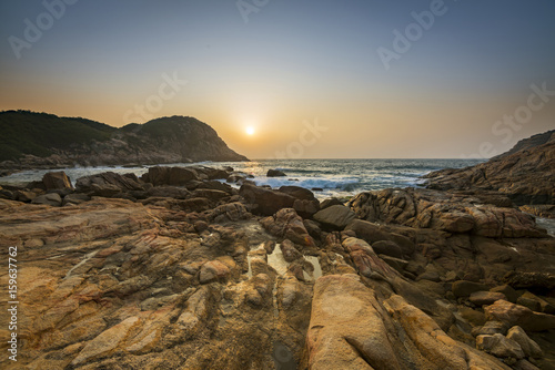 Fotografering  Sunrise over Shek O beach, Hong Kong