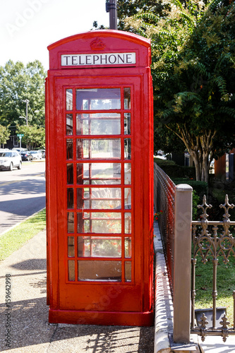 A British Red Telephone box in Oxford Mississippi Poster