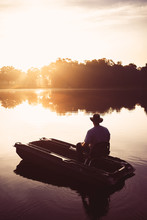 Man In Small Fishing Boat On L...