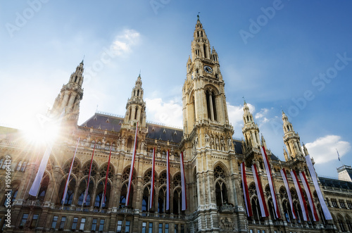 The Wiener Rathaus (Vienna City Hall, Austria) at sunset, with austrian flags over the facade