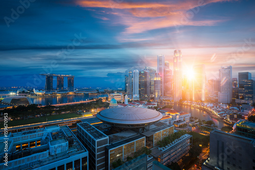 Obraz na plátne  Singapore city with sunrise by day to night photo