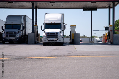Fotografie, Obraz  Semi Trucks are at the gas station for refueling