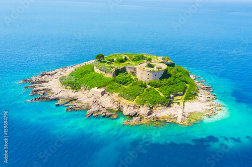 Top view of the island with a fortress in the sunlight