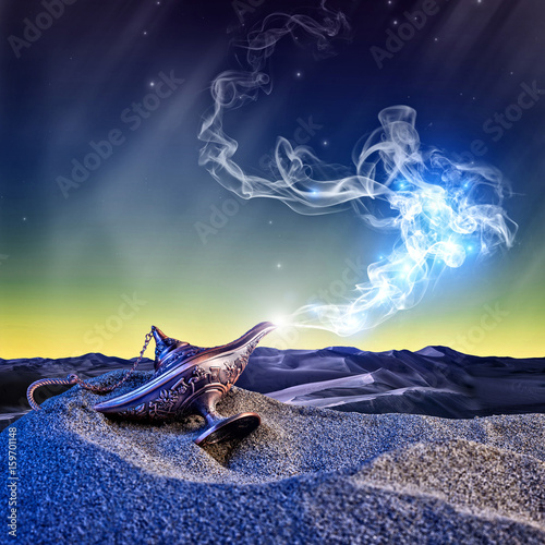 Fotomural magical aladdin lamp with smoke coming out in a night resting on the dunes of a desert