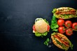 Hamburger with cheese, meat and green onions on Wooden background. Top view. Free space.