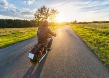 Dark Motorbiker Riding High Power Motorbike In Sunset