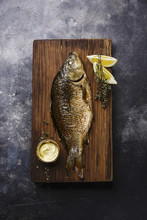 Baked Carp With Lemon And Sauc...