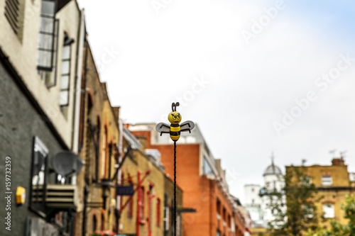 Poster Stockholm Representation of a bee flying on a street in London