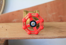 Brass Valve With Red Knob In A...