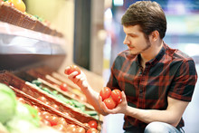 A Young Man Shopping For Fruit And Veg