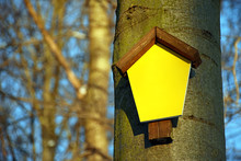 Small Signboard With A Wooden Roof And Yellow Surface For Self-marking, Mounted On A Tree In The Forest