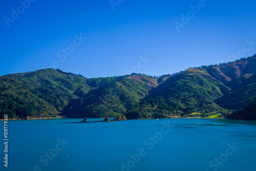 Foto auf Gartenposter Reflexion Beautiful landscape of mountain with gorgeous blue sky in a sunny day seen from ferry from north island to south island, in New Zealand