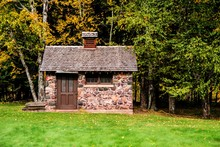 Tiny Stone House. Side View Of...