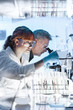 canvas print picture - Health care researchers working in life science laboratory. Young female research scientist and senior male supervisor preparing and analyzing microscope slides in research lab.