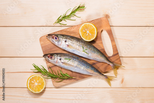 Fish dish cooking with various ingredients Fototapeta