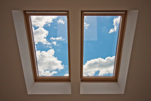 Skylights. View From The Window. View Of The Sky From The Window. Window On The Roof. Sunlight Through The Attic Window. Light In The House
