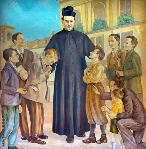 Photo TURIN, ITALY - MARCH 15, 2017: The painting of Saint Don Bosco in the middle of his boys in church Basilica Maria Ausiliatrice by Paolo Giovanni Crida (20 cent