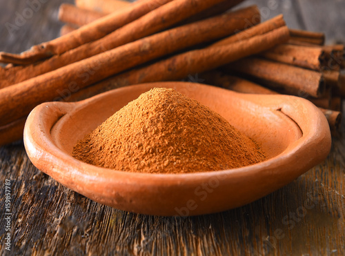 Canvas Prints Condiments Cinnamon powder in a bowl on table