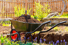 Wheelbarrow Full Of Soil In A Garden