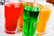Different soft drinks in a glass