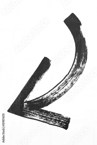 Foto  Painted curved black arrow on white background