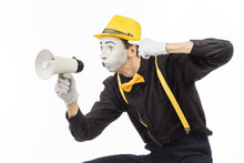 Portrait Of A Male Mime Artist, Shouting Or Showing On A Megaphone. Isolated On White Background.