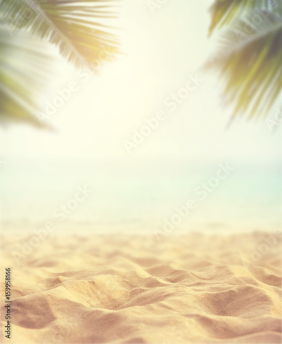 Sand with blurred Palm and tropical beach bokeh background, Summer vacation and travel concept. Copy space Wall mural