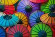 Leinwanddruck Bild - Colorful paper umbrellas on store shelves. Laos