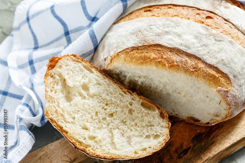 Sliced crusty homemade organic french bread. Canvas-taulu