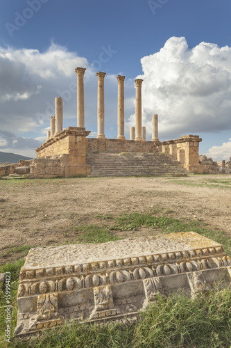 Ruins of roman Capitolium in Thuburbo Majus with architrave in foreground, Tunis Canvas Print