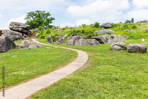 Fotografie, Obraz  Trail leading to Devil's Den in Gettysburg battlefield national park with rock b