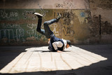 Young man breakdancing outdoors