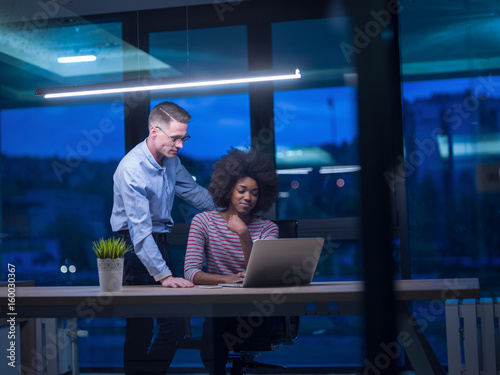 Fototapety, obrazy: Multiethnic startup business team in night office