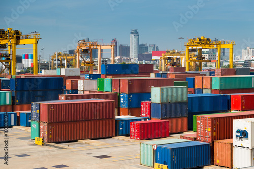Photo  Containers are at marshaling yard at port.