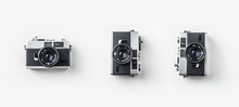 Top View Of Vintage Cameras On White Background Desk For Mockup, Collection Of Diverse Angle.