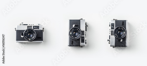 Foto op Plexiglas Retro Top view of vintage cameras on white background desk for mockup, collection of diverse angle.