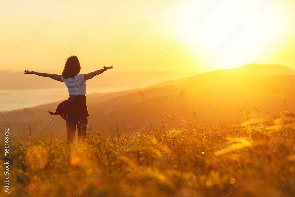 Fototapety, obrazy: Happy woman standing with her back on sunset in nature iwith open hands.