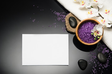 Obraz na płótnie Canvas Spa concept background on black reflective background. Top view frame product photograph with copy space. Concept photograph with room for text or advertising.