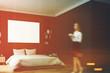 Black bedroom interior, woman, wall