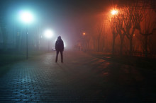 Man Stand Alone At The Foggy Street