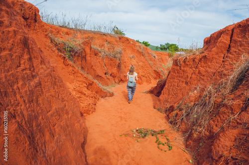 Keuken foto achterwand Rood traf. Young woman in red canyon near Mui Ne, southern Vietnam
