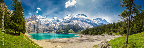 Fotobehang Alpen Amazing tourquise Oeschinnensee with waterfalls in Swiss Alps, Kandersteg, Switzerland
