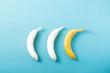 Leinwanddruck Bild - White and yellow bananas on pastel blue background. Minimal fashion, flatlay , top view. Albino Different Creativity Creative Thinking Ideas Concept