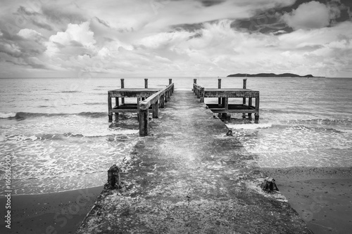 Black and white image of the old jetty, in a scary atmosphere.