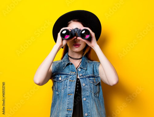 woman in hat with binocular