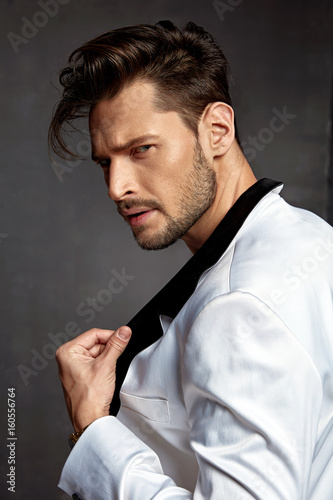 Portrait of a dark-haired young model wearing white jacket Fototapeta