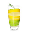Glass of tasty lemonade with slices of citrus fruits on white background