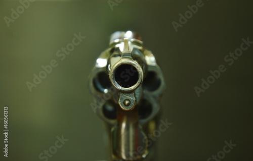 Fotografía  revolver gun muzzle ready to shoot on black background
